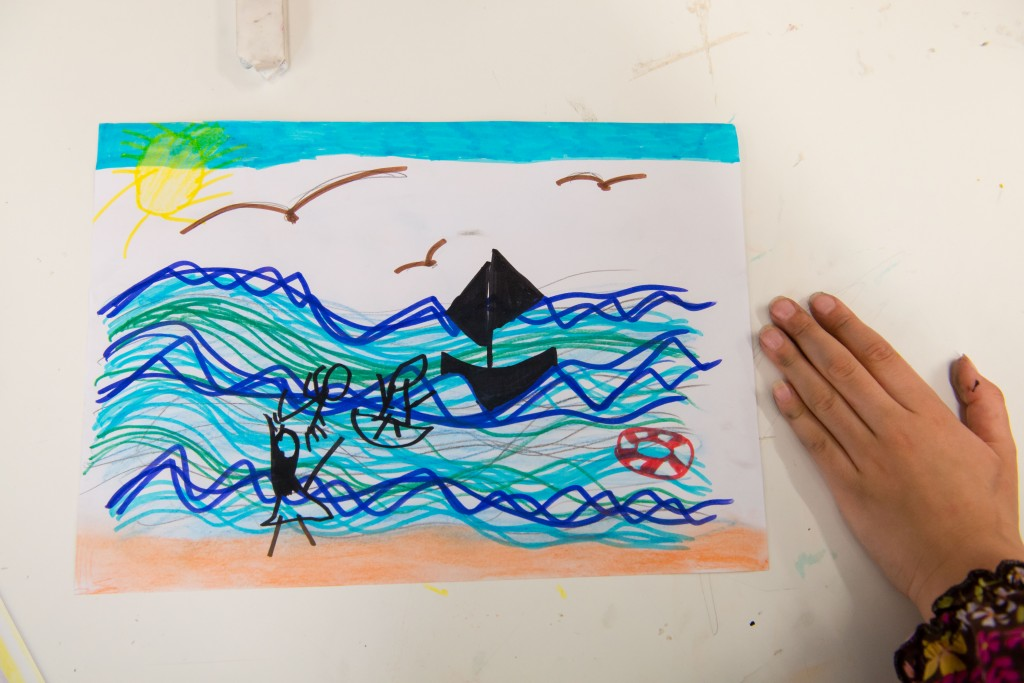 I was inspired by the sounds of the sea. A child helped me by suggesting and then drawing what she thinks about when she hears the seaside.