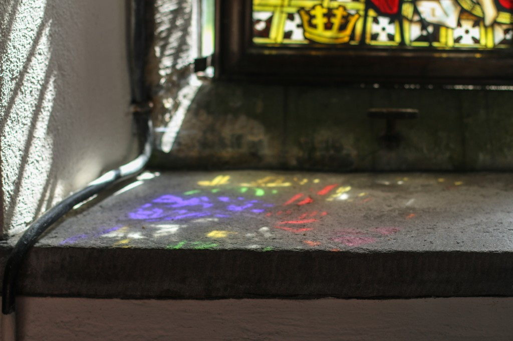Beautiful colourful light patterns from the sun shining through the stained glass window
