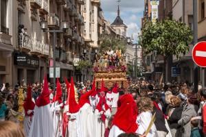 Nazarenos leading the paso through the streets